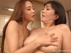 Passionate Japanese lesbian enjoys getting her pussy fingered close up tube porn video
