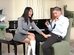 Mini-skirt clad Asian babe with a shaved pussy enjoying a hardcore doggy style fuck tube porn video