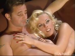 Glamorous blond Kelly Trump enjoys a nice long anal fuck tube porn video