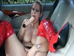 German slut fucks herself on the backseat tube porn video