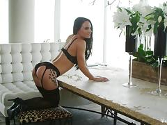 Tattooed cowgirl in stockings stripteases lovely while displaying her nice ass tube porn video