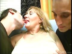 Mature granny pegging her partner with a strap on in a threesome tube porn video