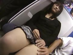 A crazy Japanese couple fucks on a crowded public tram tube porn video