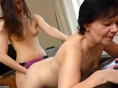 old nanny takes a strap on from her young lover tube porn video