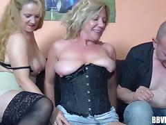 First threesome for a mature blonde in a black corset tube porn video
