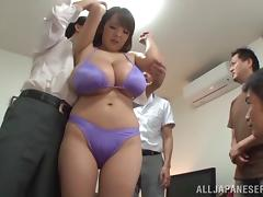 Long haired Japanese bitch in bra exposes her giant tits to these horny studs tube porn video