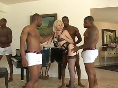 Daring blonde enjoys riding big black cocks in this interracial gang bang action tube porn video