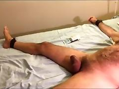 Intensive ball busting in restraints tube porn video