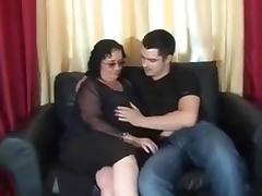 Chubby brunette cougar submits to my young friend on the sofa tube porn video