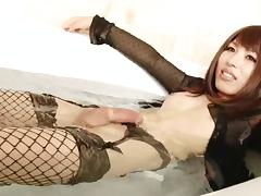 Japanese tgirl in sexy black fishnets strokes her sexy dick tube porn video