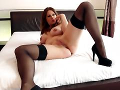 Busty babe fucked on a bed in black stockings tube porn video