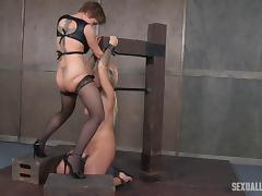 Dominant lady pushes the strap-on dildo down the prisoner's throat tube porn video