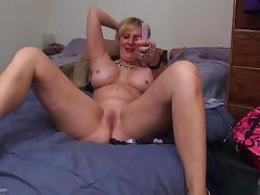 Blonde mature bombshell with big tits pleasures her twat with a toy tube porn video