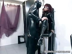 Redhead bitch in latex cloth gets pussy tube porn video