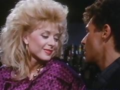 Horny blond babe Nina Hartley gets banged in the bar tube porn video