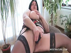 Busty mature BBW tries sex toys in hairy snatch tube porn video
