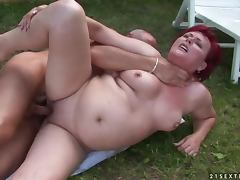 Redhead granny Eszmeralda sucks and rides a cock in the garden tube porn video