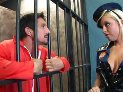 Pretty babe Britney Amber gives a blowjob in the prison tube porn video