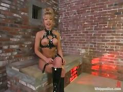 Janay gets whipped by blonde mom Kathleen in a basement tube porn video
