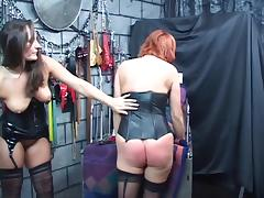 Sexy brunette whips and spanks redhead bent over table tube porn video