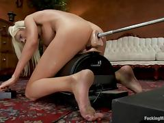 Busty blonde Puma Swede takes a ride on a fucking machine tube porn video