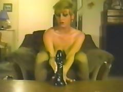Milf in stockings is penetrating herself with a dildo tube porn video