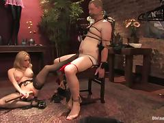 A nerd gets humiliated and tormented by a mistress in BDSM scene tube porn video