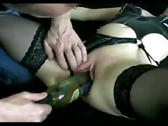 Milf gets fucked by a wine bottle tube porn video