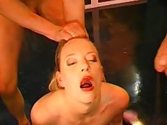 Slutty blonde gets her face covered with cum on the blowbang action tube porn video