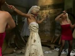 Blonde chick in a wedding dress gets tortured by bridesmaid tube porn video