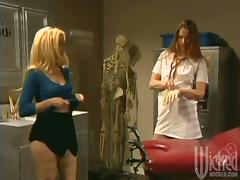 Cute blonde babe gets toyed by a doctress in a hospital tube porn video