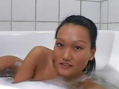 Tanned Asian Vanessa is poking her puss tube porn video