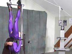 suspended in purple catsuit tube porn video