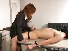 Delightful Japanese milf in an office suit gives hand work tube porn video