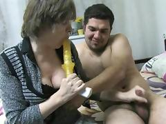 old nanny sucks on a sex toy and a cock tube porn video