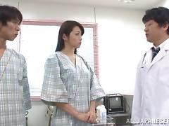 Kinky doctors probe a Japanese girl's hairy pussy in an exam room tube porn video