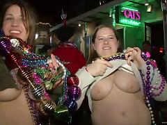 It's tits for beads as bitches flash during Mardi Gras tube porn video